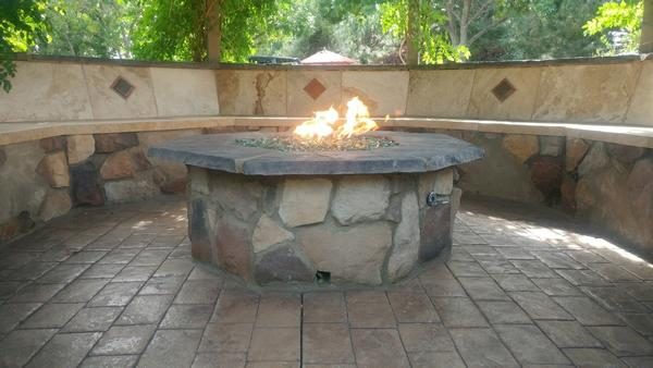 How can I enhance my outdoor living space with a fire feature?